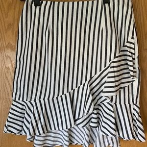 Dresses & Skirts - Dark gray and white ruffle skirt.  Never worn.